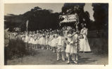 Students from Mill Valley walk to the second annual May Day celebrations in Kentfield, California,...