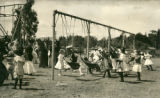 Children at the playground, Kentfield May Day Celebration, circa 1911 [photographic postcard]